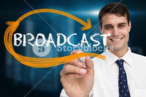 Businessman writing the word broadcast