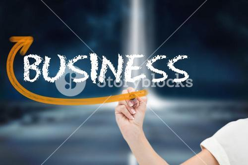 Businesswoman writing the word business