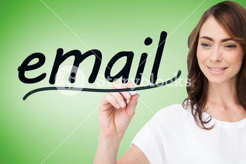 Businesswoman writing the word email