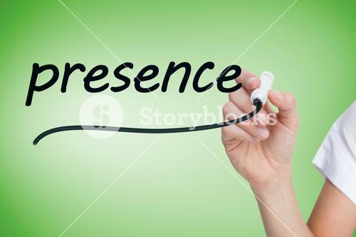 Businesswoman writing the word presence