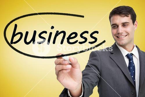 Businessman writing the word business