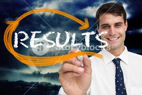 Businessman writing the word results