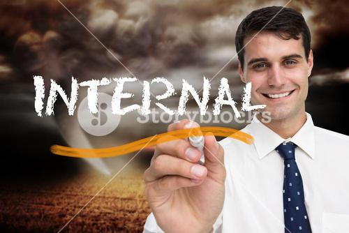 Businessman writing the word internal