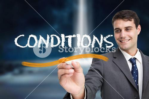 Businessman writing the word conditions