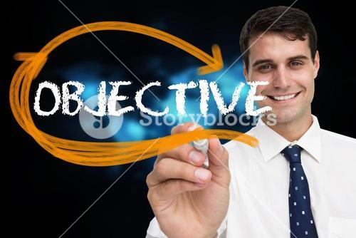 Businessman writing the word objective