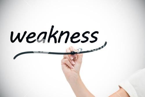 Businesswoman writing the word weaknesses
