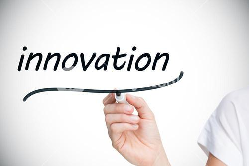 Businesswoman writing the word innovation