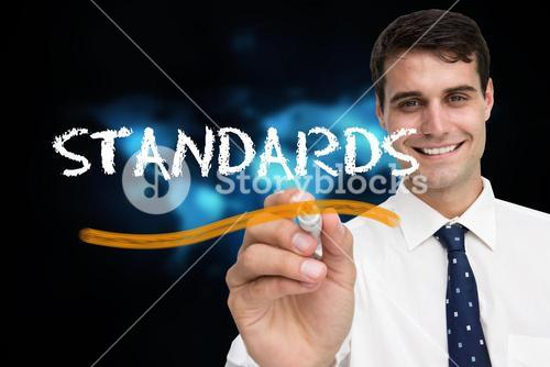 Businessman writing the word standards