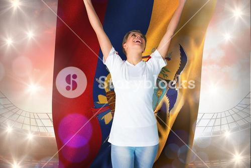 Composite image of pretty football fan in white cheering holding ecuador flag