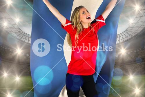 Composite image of cheering football fan in red holding honduras flag