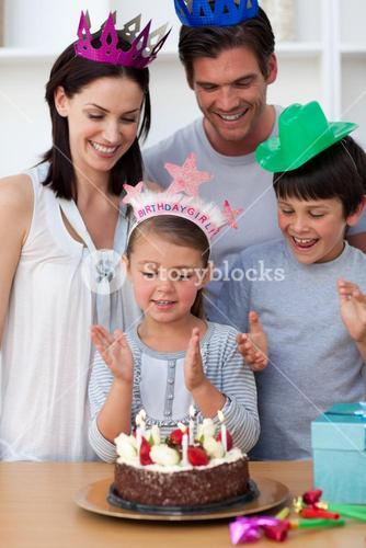 Portrait of a young family celebrating a birthday