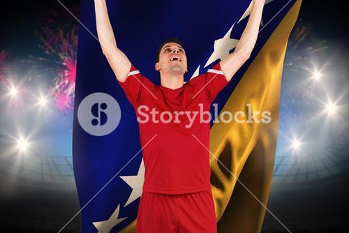 Composite image of excited football player cheering