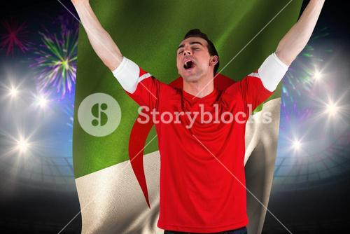Composite image of excited football fan cheering