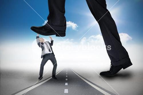 Composite image of businessman stepping on tiny businessman