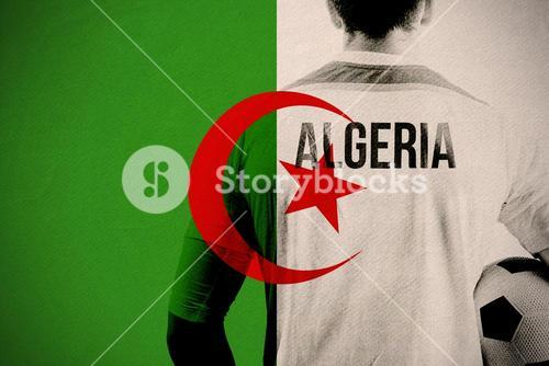 Composite image of algeria football player holding ball