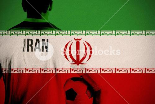 Composite image of iran football player holding ball