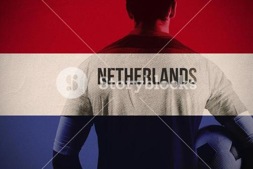 Composite image of netherlands football player holding ball