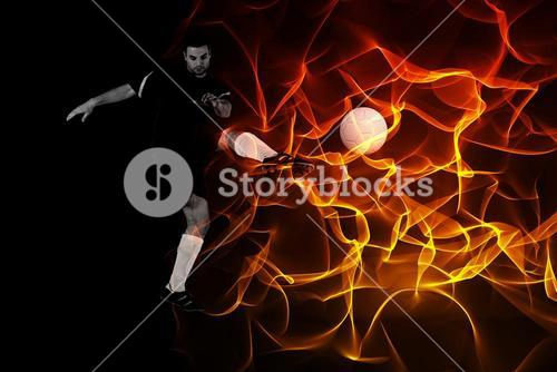 Composite image of football player in red kicking