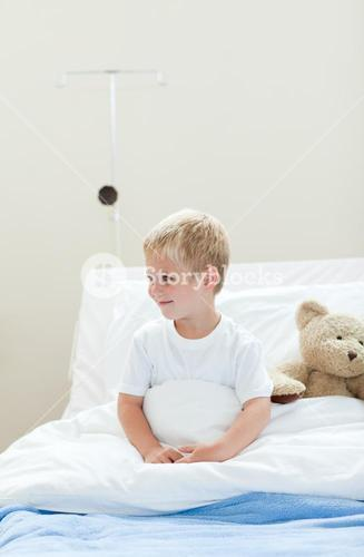 Smiling little boy on a hospital bed