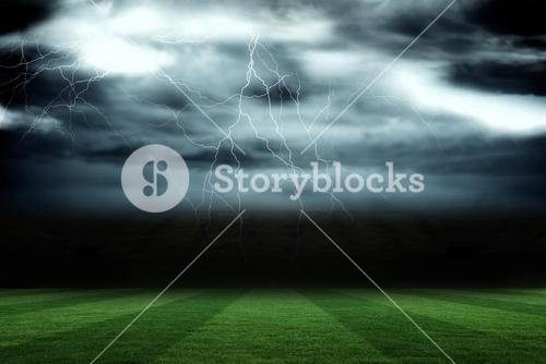 Football pitch under stormy sky