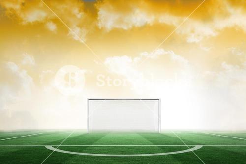 Football pitch under yellow sky