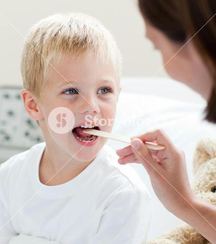 A doctor examining a childs throat