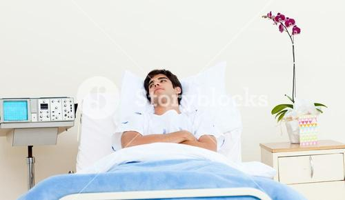 Male patient lying on a hospital bed