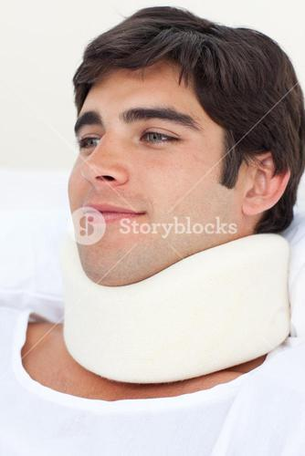 Close up of a young male patient wearing a neck brace