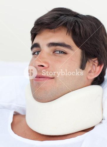 Close up of an attractive male patient with a neck brace