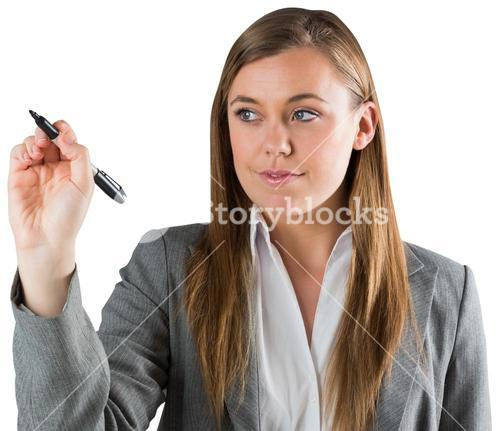 Smiling businesswoman writing with pen