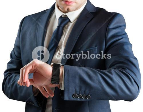 Businessman checking the time on watch