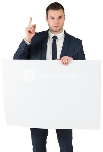 Businessman holding card and pointing up