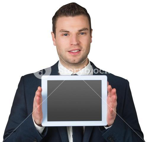 Businessman showing tablet pc screen
