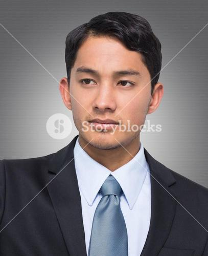 Composite image of stern asian businessman