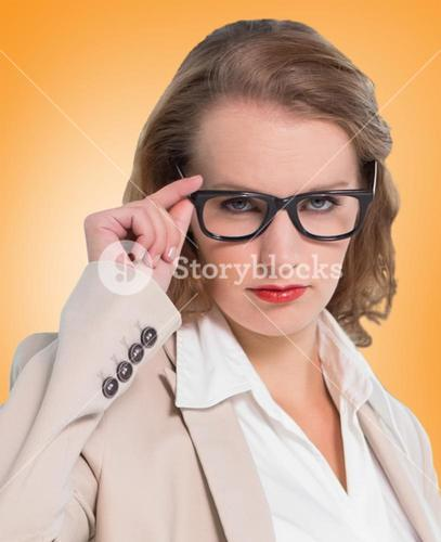 Composite image of severe pretty businesswoman looking at camera