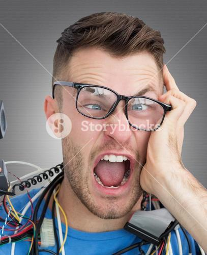 Composite image of frustrated computer engineer screaming while on call in front of open cpu