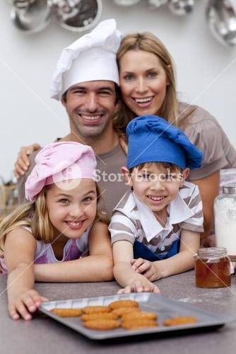Happy children and parents eating biscuits