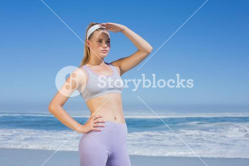 Sporty focused blonde on the beach