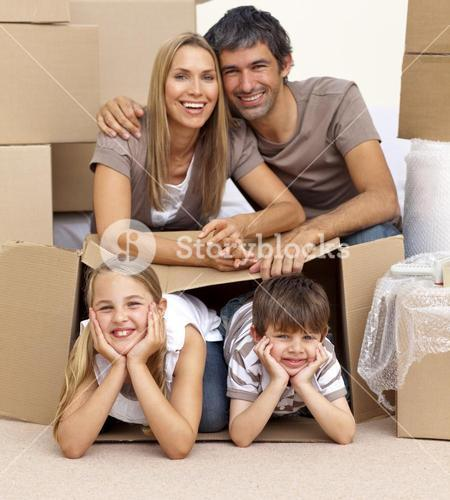 Family in new house playing with boxes