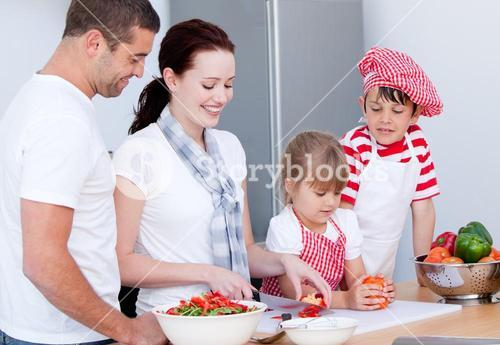 Portrait of a adorable family preparing a meal