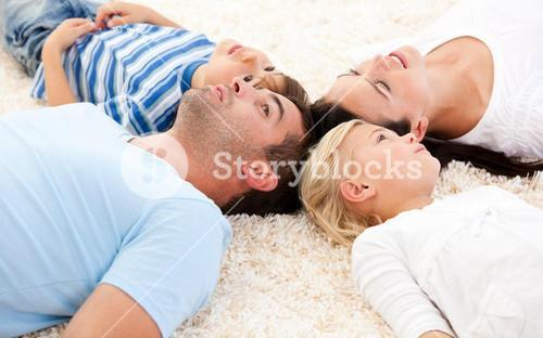 Happy family lying on the floor together