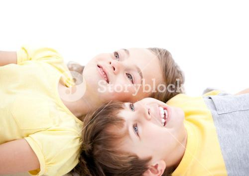 Smiling childrens lying on the floor together