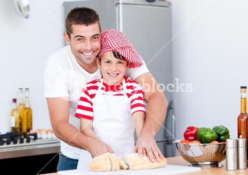 Portrait of a smiling father and his son preparing a meal