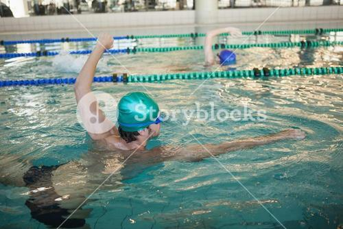 Man and woman racing in the swimming pool