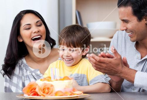 Laughing family celebrating a birthday together