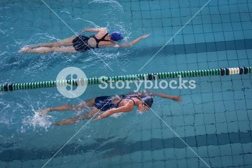 Female swimmers racing in the swimming pool