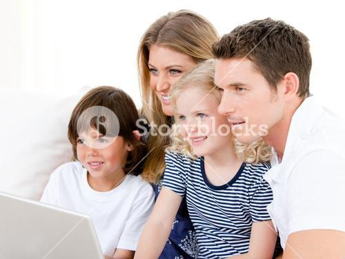 Smiling family surfing on internet