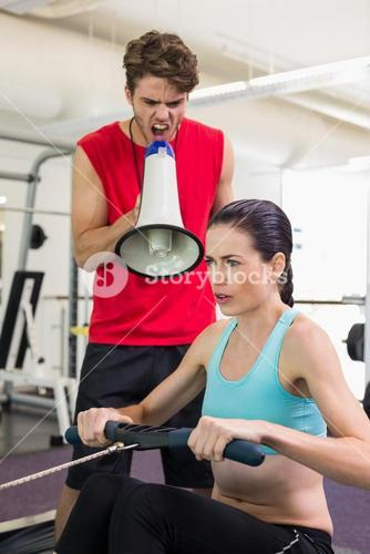 Trainer shouting at client through megaphone