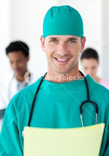 Surgeon holding a patients folder
