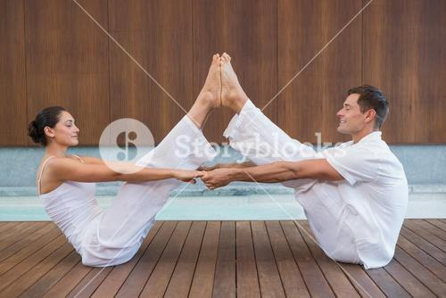Peaceful couple sitting in boat position together